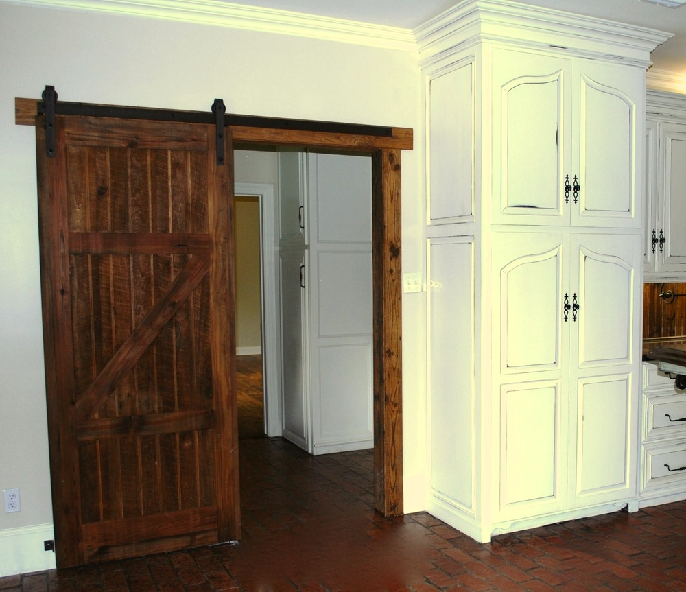 Kitchen after with addition of barn door.JPG