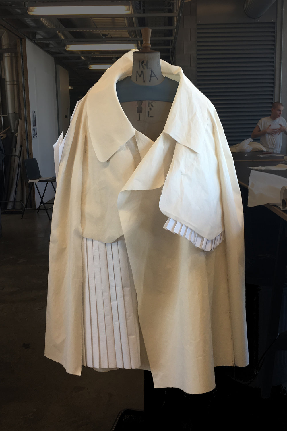 PROCESS: putting the finishing pleats into the trench's front