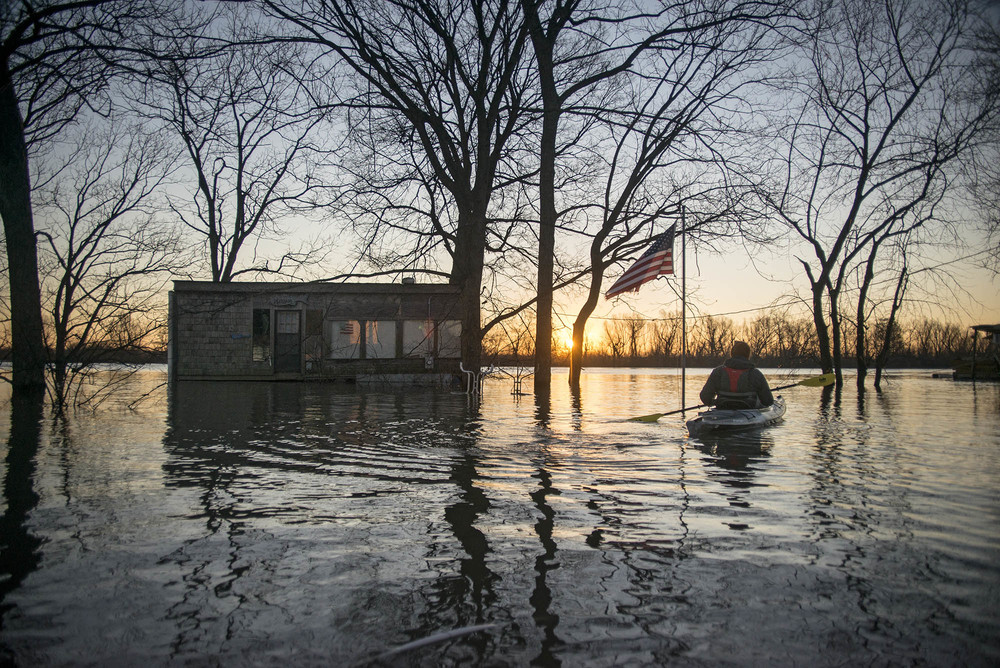 Settled on the River Side of the protective levees, Mound City and other communities were flooded under more than 12 feet of water in places despite being nearly three miles from the Mississippi River's main channel. Beside each floating structure are single-story homes, sheds and other structures hidden underwater, completely inundated by the flood.