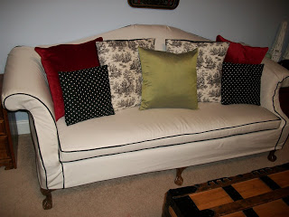 Tiffany in her new slipcover with pillows