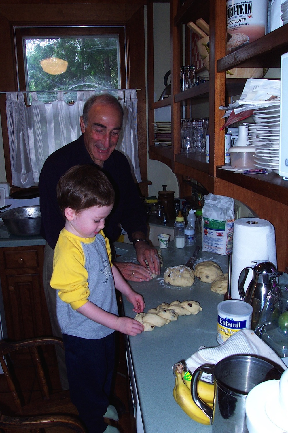 Harvey baking challah  (12 years ago!)  with grandson Abe, named after Hilda's late husband.