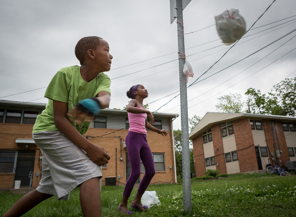 Zi'IonGray, 9, goes for a wrap while playing tetherball against his cousin, Alahzeyai Harvey, 11, on their block Sunday, May 10, 2015.