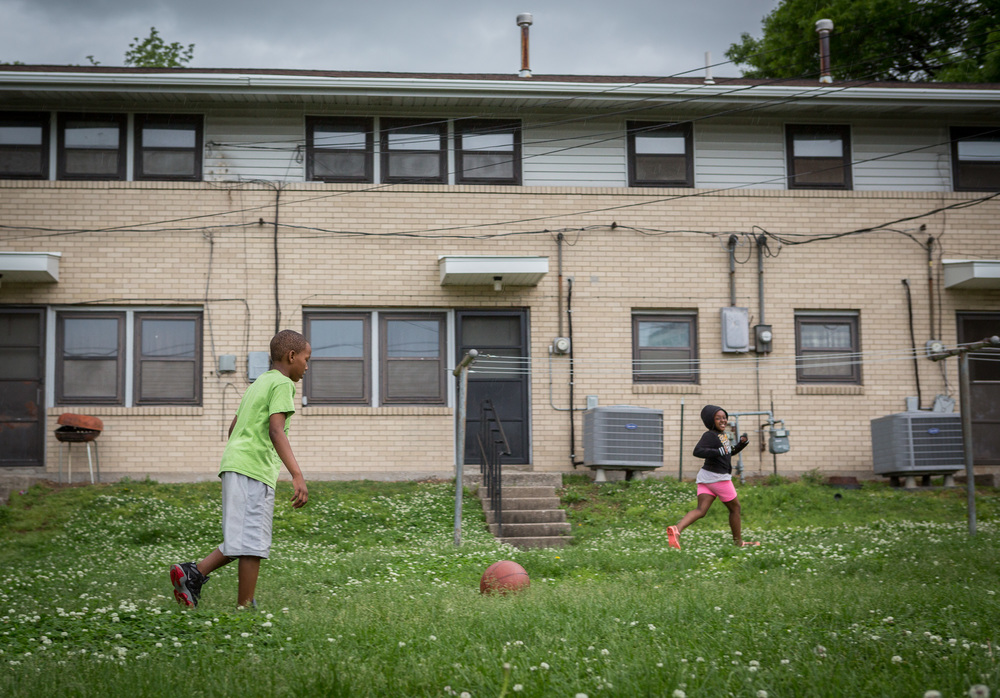 Zi'Ion Gray, 9, and his sister Zi'Airea Gray, 7, head for home as rain starts to fall.