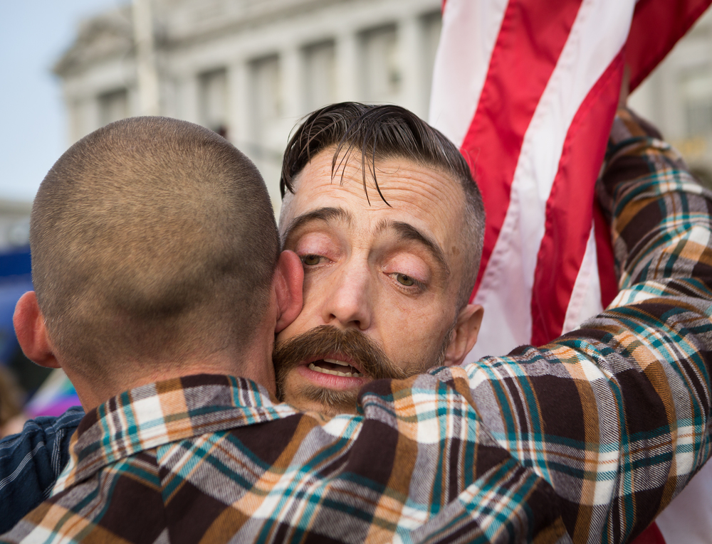 Joe Capley-Alfano (right) embraces husband Frank Capley-Alfano moments after finding out the Supreme Court's positive ruling on same-sex marriage in front of City Hall in San Francisco, California, on Friday, June 26, 2015.