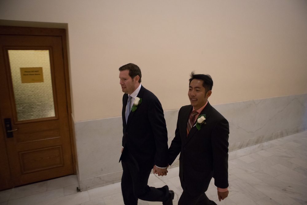 Mark Streeter (left) and partner Hai Nguyen walk through City Hall in San Francisco, California, on their way to get married shortly after the Supreme Court's ruling in favor of same-sex marriage on Friday, June 26, 2015.