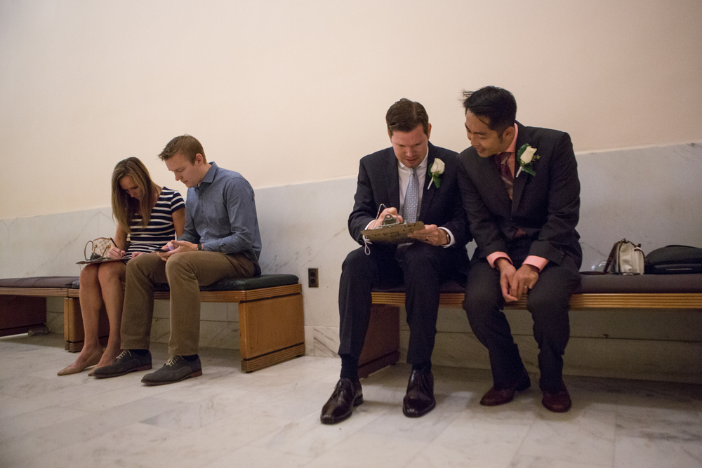 From right: Hai Nguyen and partner Mark Streeter fill out paperwork to receive their marriage license as Ben Byrne and soon-to-be wife Lauren Blears do the same at City Hall in San Francisco, California, on Friday, June 26, 2015. The Fourteenth Amendment requires a state to license a marriage between two people of the same sex.