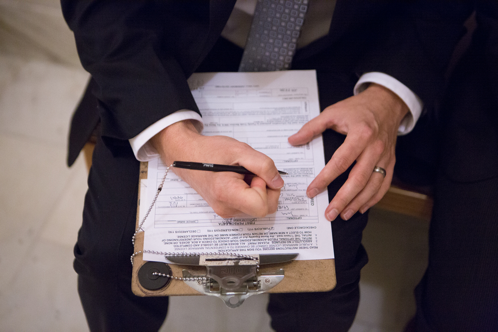 Mark Streeter fills out paperwork to receive a marriage license with partner Hai Nguyen (not pictured) at City Hall in San Francisco, California, shortly after the Supreme Court's ruling in favor of same-sex marriage on Friday, June 26, 2015.