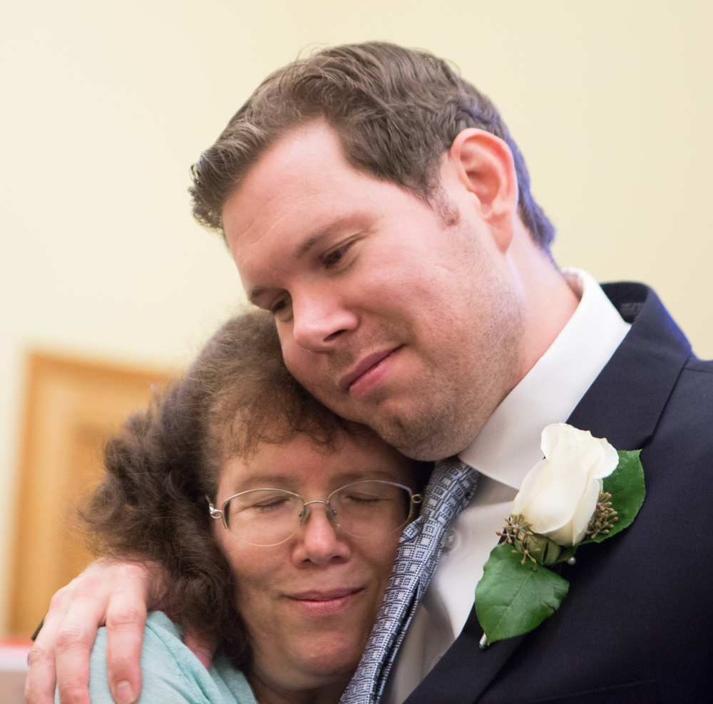 Mark Streeter hugs his mother, Linda Streeter, while waiting with partner Hai Nguyen (not pictured) to receive a marriage license at City Hall in San Francisco, California, shortly after the Supreme Court's ruling in favor of same-sex marriage on Friday, June 26, 2015.