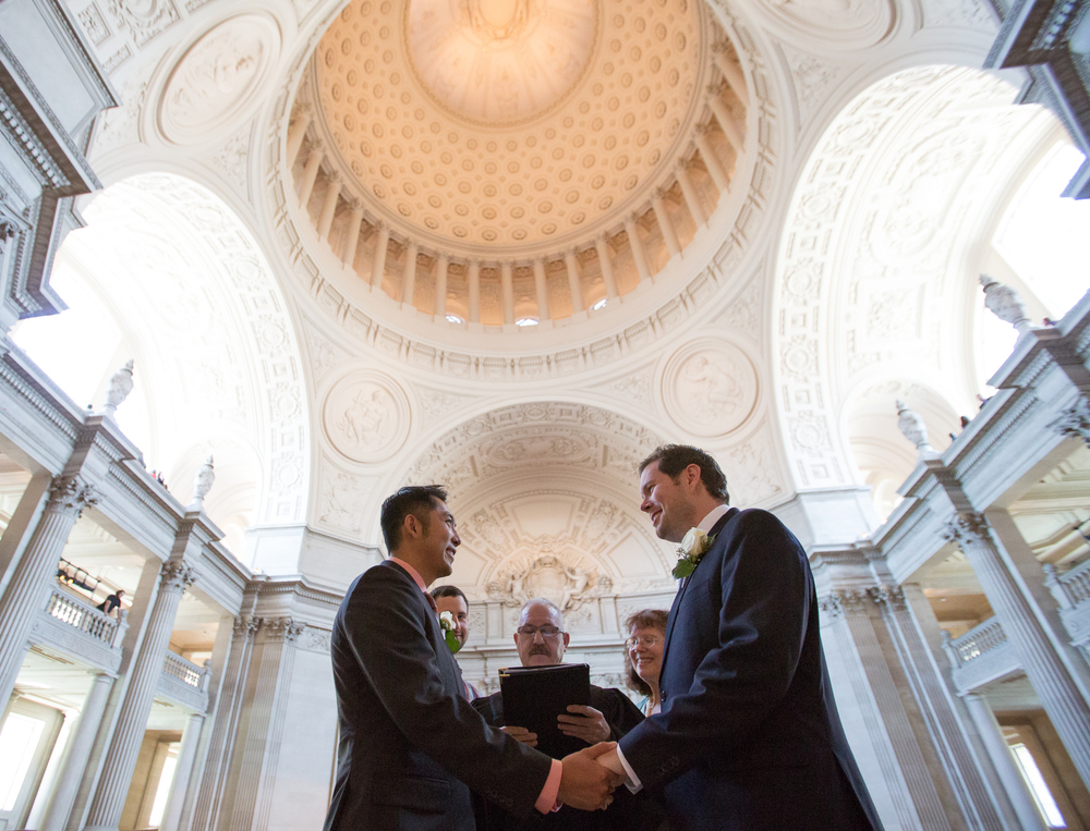 Hai Nguyen (left) and Mark Streeter are married by Deputy Marriage Commissioner John Pleskach at City Hall in San Francisco, California, shortly after the Supreme Court's ruling in favor of same-sex marriage on Friday, June 26, 2015.