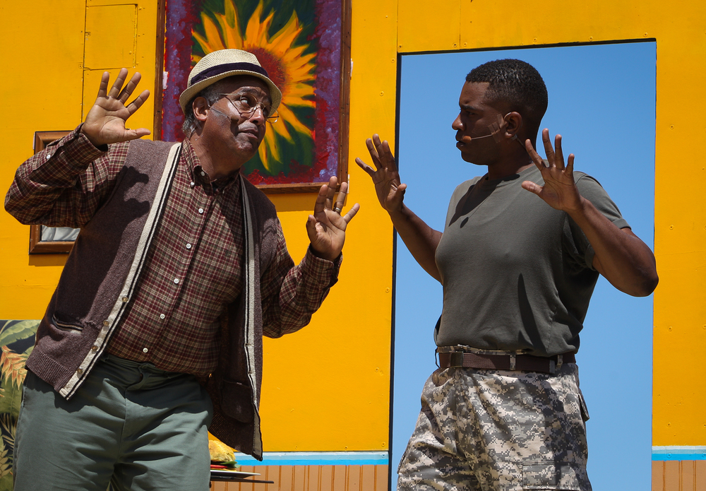 Actors Michael Gene Sullivan (left) and George P. Scott are seen during The San Francisco Mime Troupe's annual Fourth of July performance at Mission Dolores Park in San Francisco, California, on Saturday, July 4, 2015.