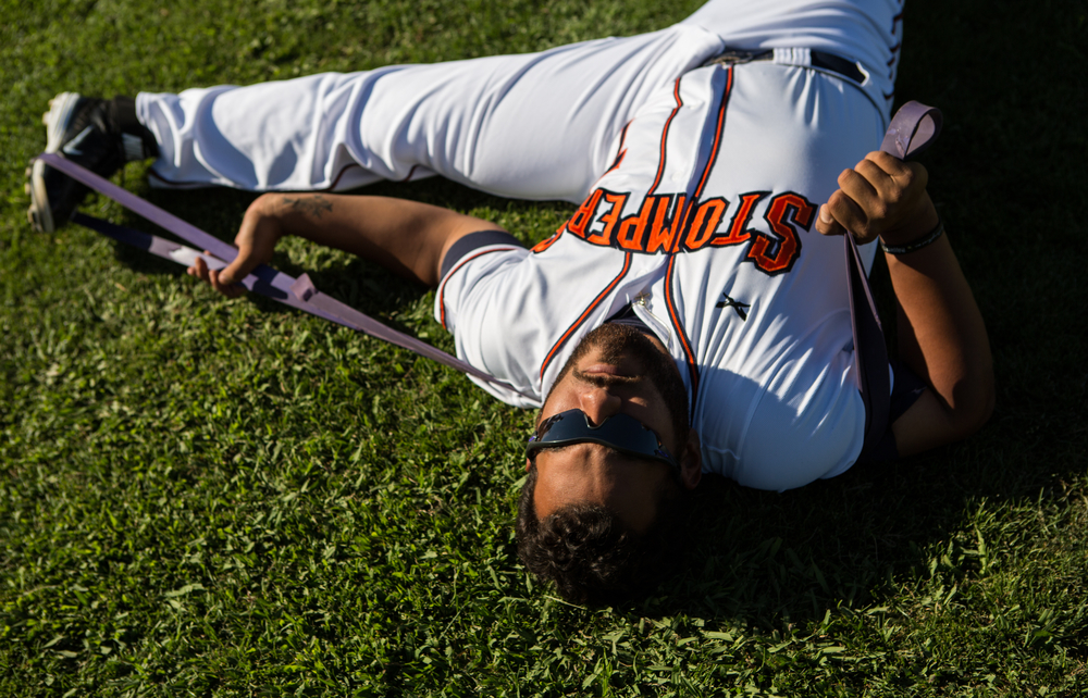 Sonoma Stompers infielder Joel Carranza stretches before a game against the Pittsburg Diamonds at Arnold Field in Sonoma, CA, on Tuesday, July 7, 2015. The Stompers blew a 9th inning lead.