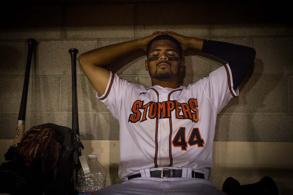 Sonoma Stompers infielder Daniel Baptista lingers in the dugout following a tough loss to the Pittsburg Diamonds at Arnold Field in Sonoma, CA, on Tuesday, July 7, 2015. The Stompers blew a 9th inning lead.