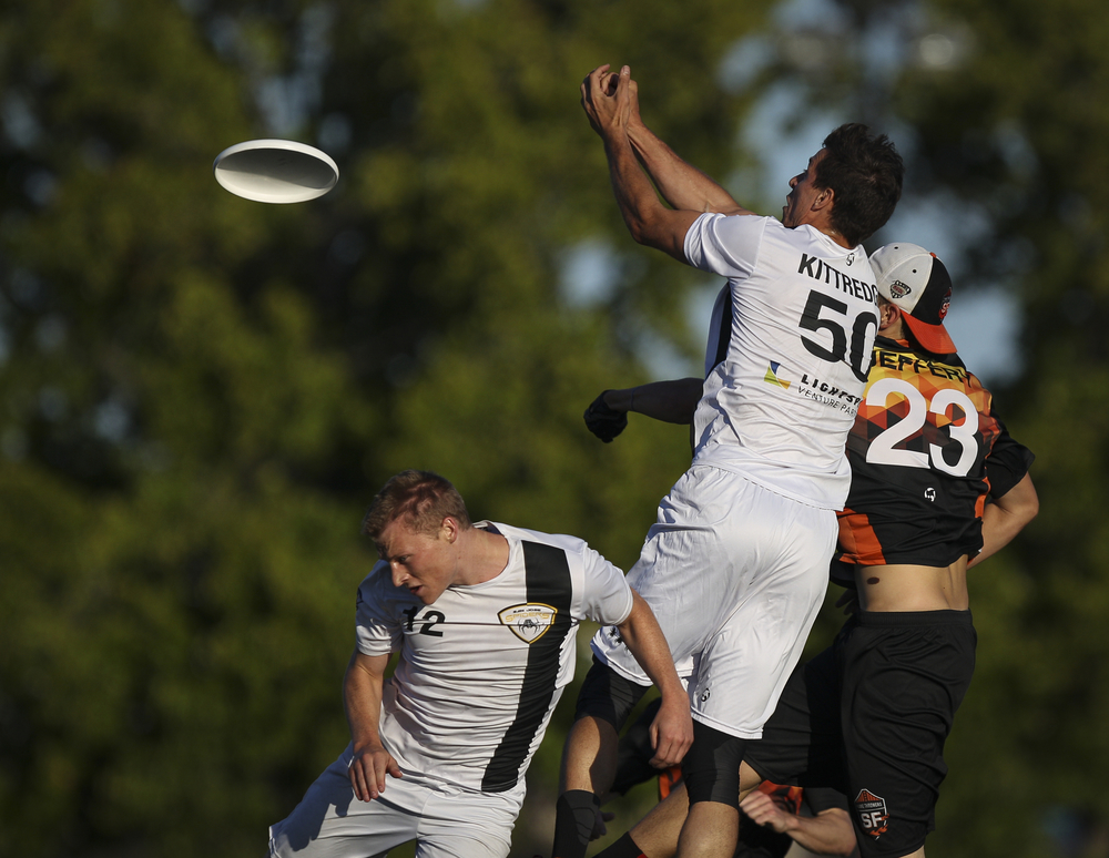 San Jose Spiders player Beau Kittredge (50) leaps for a throw against San Francisco FlameThrowers player Jordan Jeffery during an ultimate frisbee game at Laney College Football Field in Oakland, CA, on Saturday, July 18, 2015.