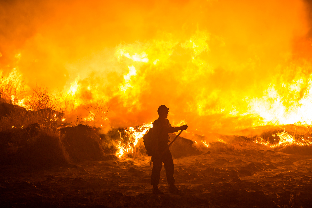 Firefighters battle the Rocky Fire along Morgan Valley Road near Lower Lake, Calif., on Friday, July 31, 2015.
