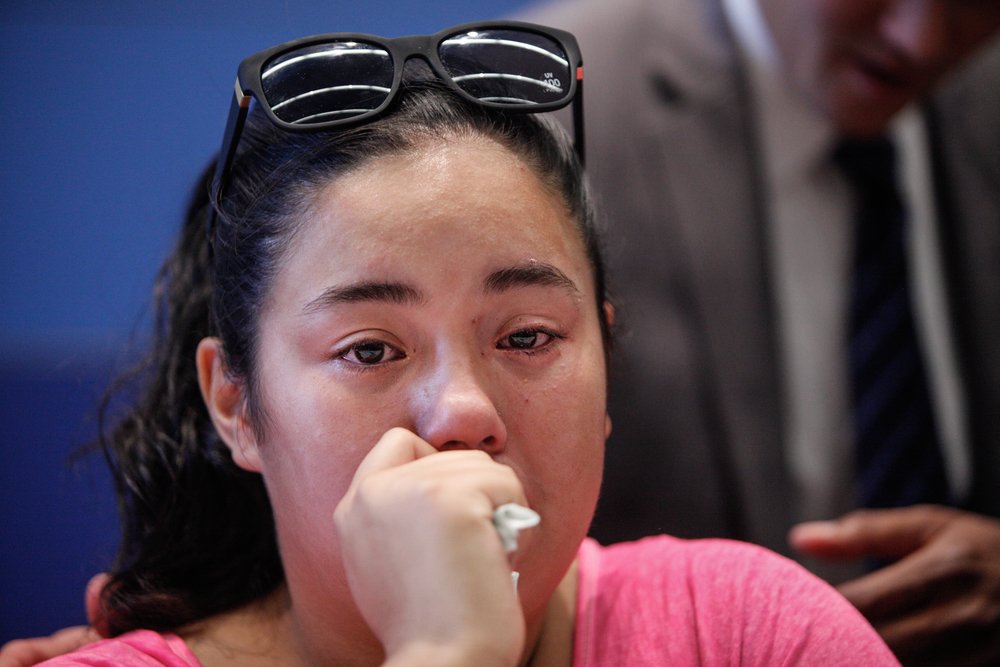 Brianna Sosa, daughter of homicide victim Lourdes Sosa, is comforted by SFPD inspector Chris Canning following a press conference regarding the January shooting at San Francisco Police Headquarters in San Francisco, Calif., on Tuesday, Aug. 18, 2015. Lourdes Sosa was in front of her home when struck by a shooter in a passing truck.