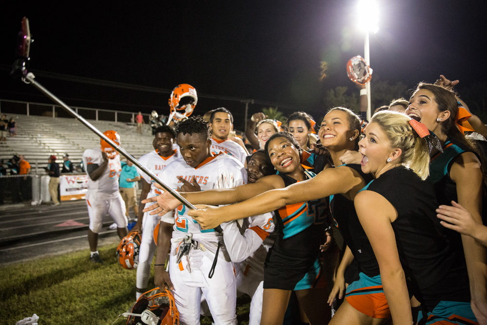 Plant City High cheerleaders and football players snap a selfie after a big win against Brandon High in Brandon, Fla., on Friday, Sept. 11, 2015.