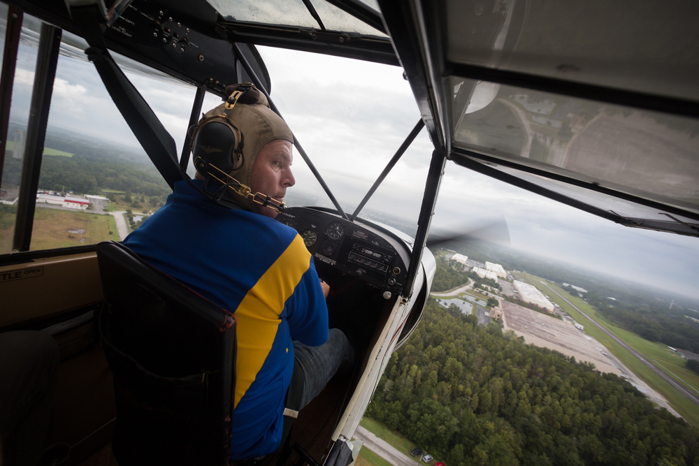 Pilot Keith Carver flies his Super Cub airplane over Lutz, Fla., during the Festival of Flight on Sunday, Sept. 13, 2015.