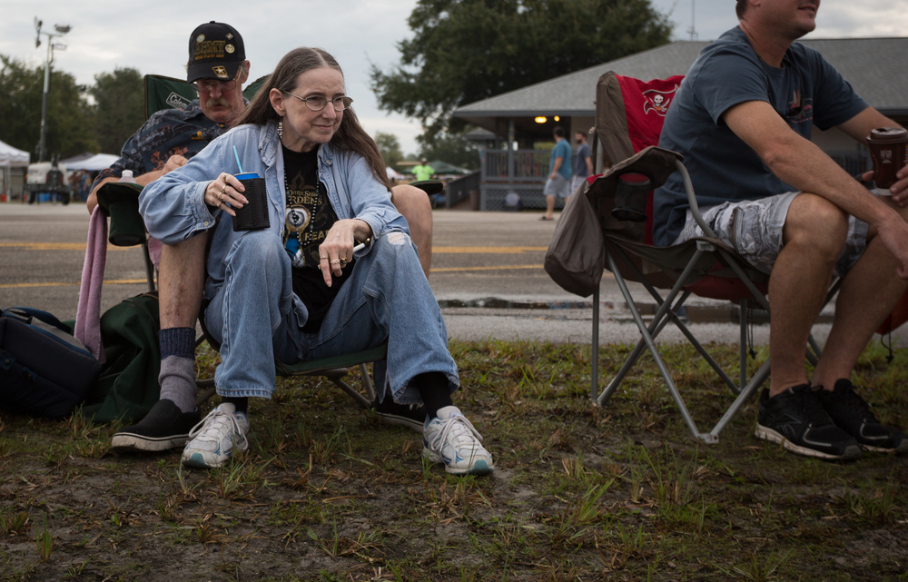 Sandy Price (front left) and husband Paul Price, along with fellow spectator Jason Klingel (right), watch hot air balloons get inflated during the Festival of Flight at Tampa North Flight Center in Lutz, Fla., on Sunday, Sept. 13, 2015. Balloons were not taken off the ground because of a chance of rain.