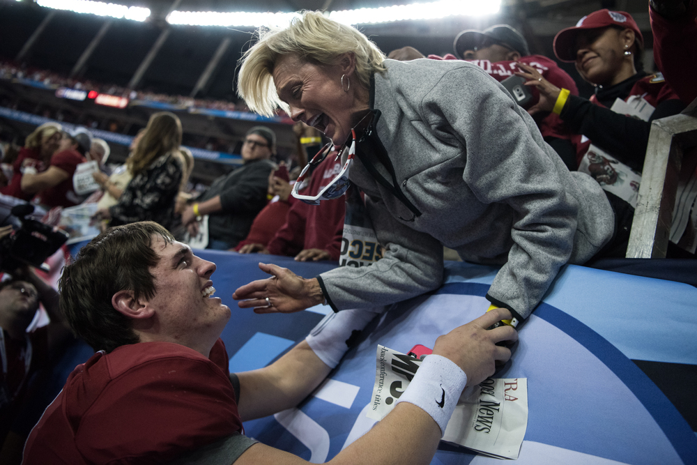 Alabama Crimson Tide quarterback Jake Coker shares a moment with his mother, Michelle Spires, after beating the Florida Gators 29-15 in the SEC championship game at the Georgia Dome in Atlanta, Ga., on Saturday, Dec. 5, 2015.
