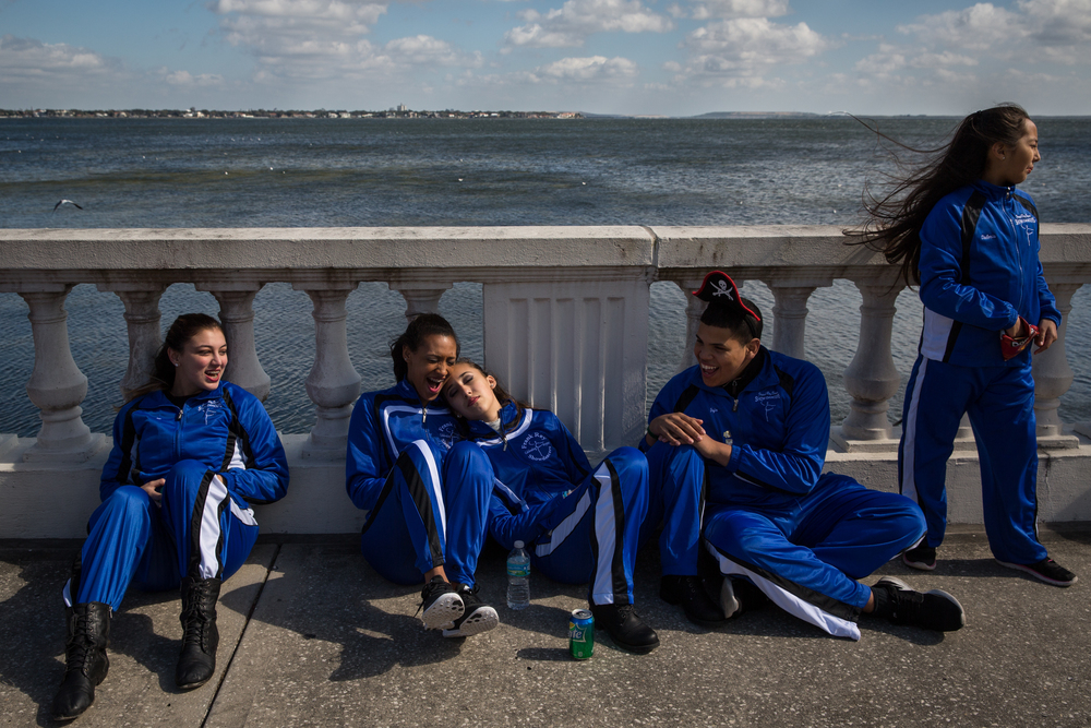 From left, Emilee Carreras, Dominique Ernewein, Marisa Lama, Jojo Almonte and Valeria Vargas of the Frank Rey Show Dancers kill time before the start of the Gasparilla Children's Parade along Bayshore Boulevard in Tampa, Fla., on Saturday, Jan. 23, 2015. The dance team had its own float and a crew of dancers performed in the street behind it.