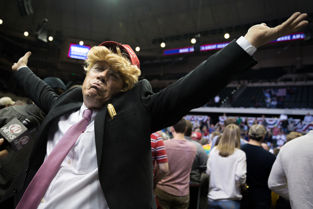 Trump supporter Todd Wertalik impersonates his favorite presidential candidate at a Donald Trump rally during the business mogul's presidential campaign at the University of South Florida Sun Dome in Tampa, Fla., on Friday, Feb. 12, 2016. Wertalik, of nearby St. Petersburg, is a registered volunteer for Donald Trump's campaign. Trump is leading Florida polls for the Republican nomination by a wide margin.