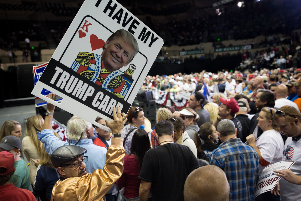 "Kevin Goldberg of Port St. Lucie holds up a homemade sign at a Donald Trump rally at the University of South Florida Sun Dome in Tampa, Fla., on Friday, Feb. 12, 2016. ""It's not about the Democrat, it's not about the Republican, it's about the guy,"" Goldberg said about his support for Trump."