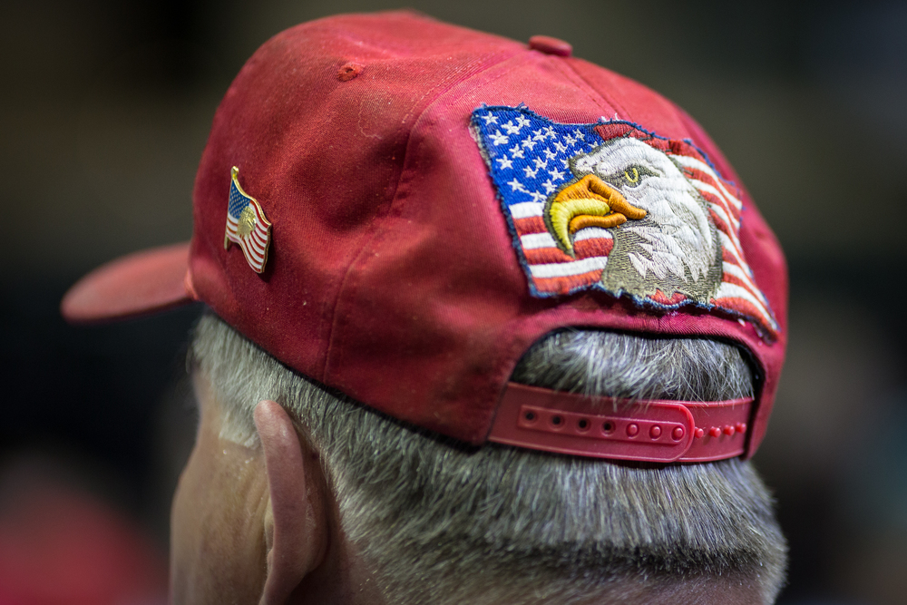 "Trump supporter Steve Griffin sports a Patriotic hat at a Donald Trump rally during the business mogul's presidential campaign at the University of South Florida Sun Dome in Tampa, Fla., on Friday, Feb. 12, 2016. ""I believe in his candidacy and I believe in what his principles are,"" said Griffin."