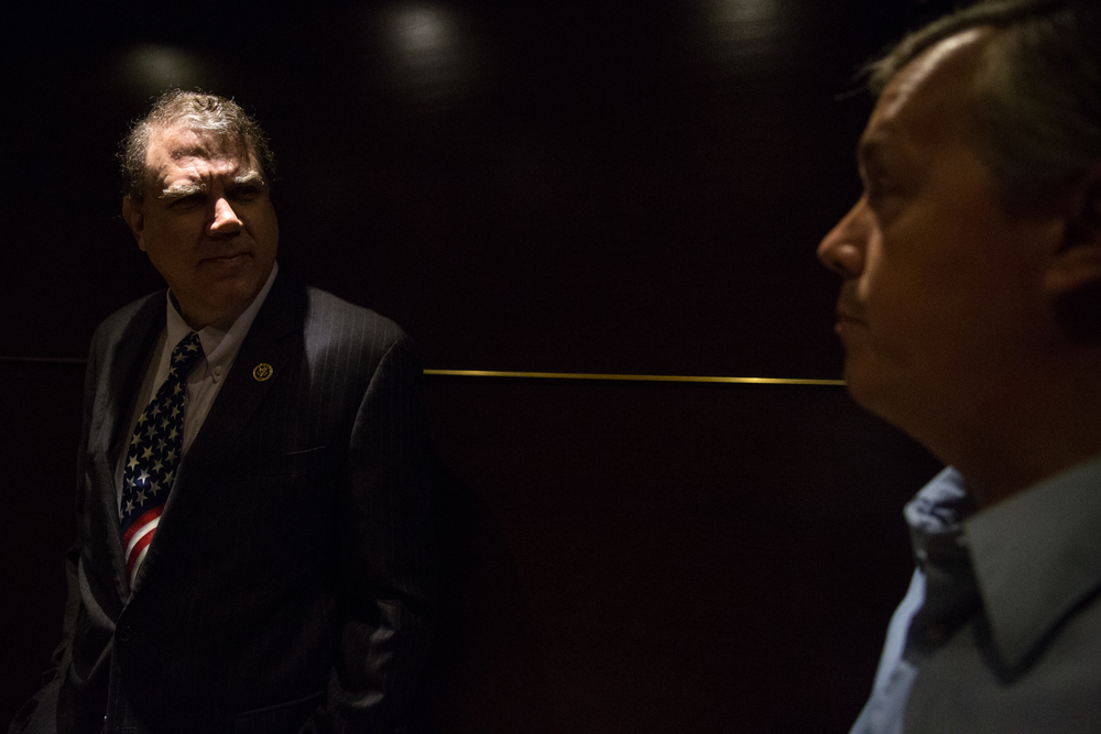Congressman Alan Grayson (left), who is running in Florida's Democratic Senate primary, is seen with campaign communications director David Damron in an elevator at the DoubleTree by Hilton Orlando Downtown hotel before speaking at a Democratic County Chairs Association meeting there. (for the New York Times)