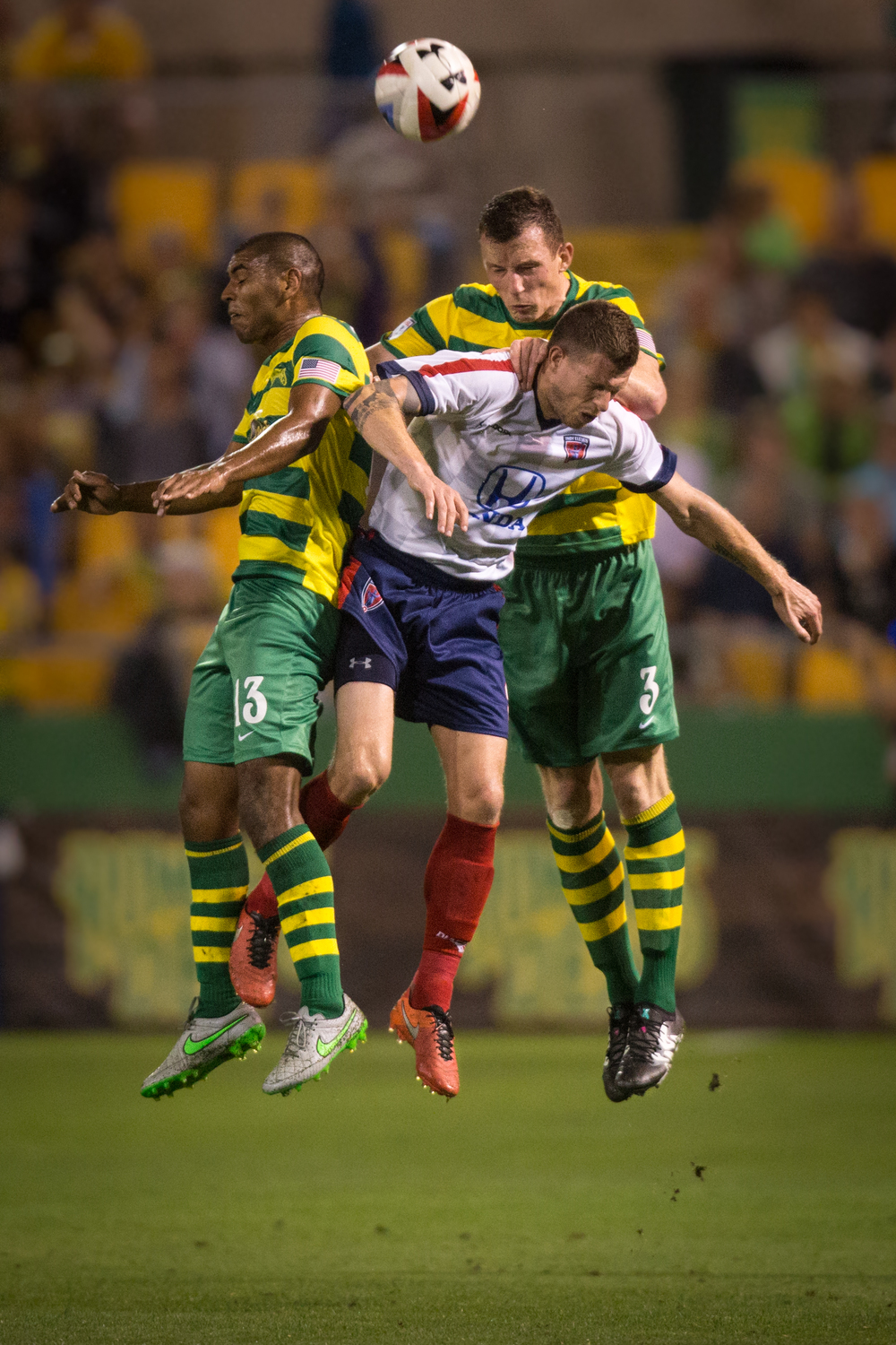 Rowdies midfielder Justin Chavez (left) and defender Neill Collins (right) go up for a header against Indy Eleven midfielder Nicki Paterson during a match at Al Lang Stadium in St. Petersburg, Fla.