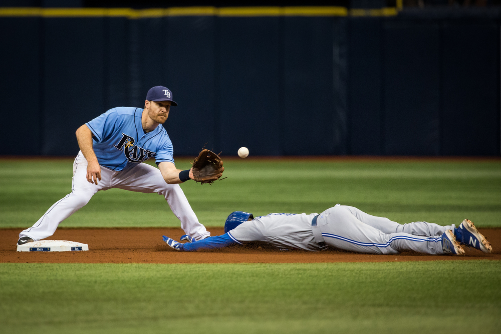 Tampa Bay Rays second baseman Logan Forsythe prepares to tag out Toronto Blue Jays left fielder Ezequiel Carrera at second on an attempted steal in the fifth inning of a game at Tropicana Field in St. Petersburg, Fla., on Sunday, May 1, 2016.