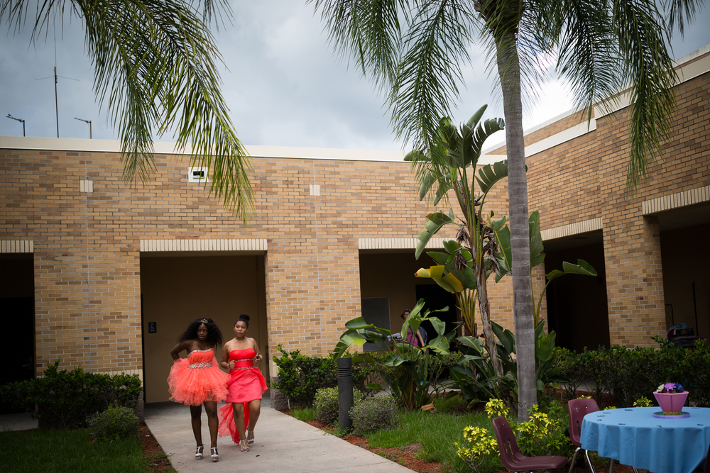 Graduating eighth-graders Kimari Smith (left) and Whitney Hughes hurry into a dance celebrating the last day of school at Orange Grove Middle Magnet School in Tampa on Friday, June 10, 2016.