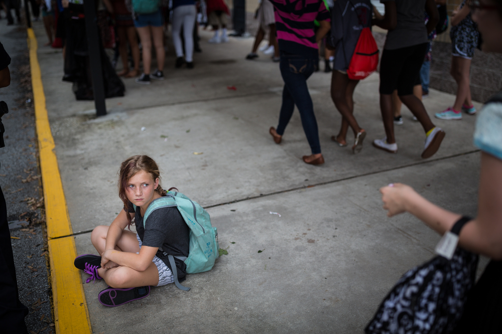 Sixth-grader Cassandra Garner, 12, waits for her dad to pick her up from school at the end of the day at Orange Grove Middle Magnet School in Tampa on Friday, June 10, 2016.