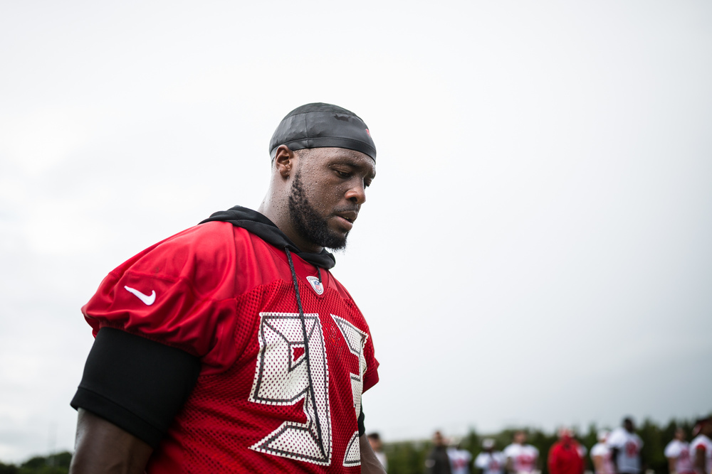 Defensive tackle Gerald McCoy of the Tampa Bay Buccaneers leaves the field after finishing a humid practice at the team's practice facility, One Buc Place, in Tampa on Thursday, June 9, 2016.
