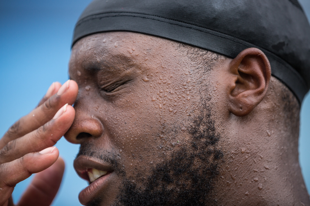 Defensive tackle Gerald McCoy of the Tampa Bay Buccaneers wipes sweat from his eyes after finishing a humid practice at the team's practice facility, One Buc Place, in Tampa on Thursday, June 9, 2016.
