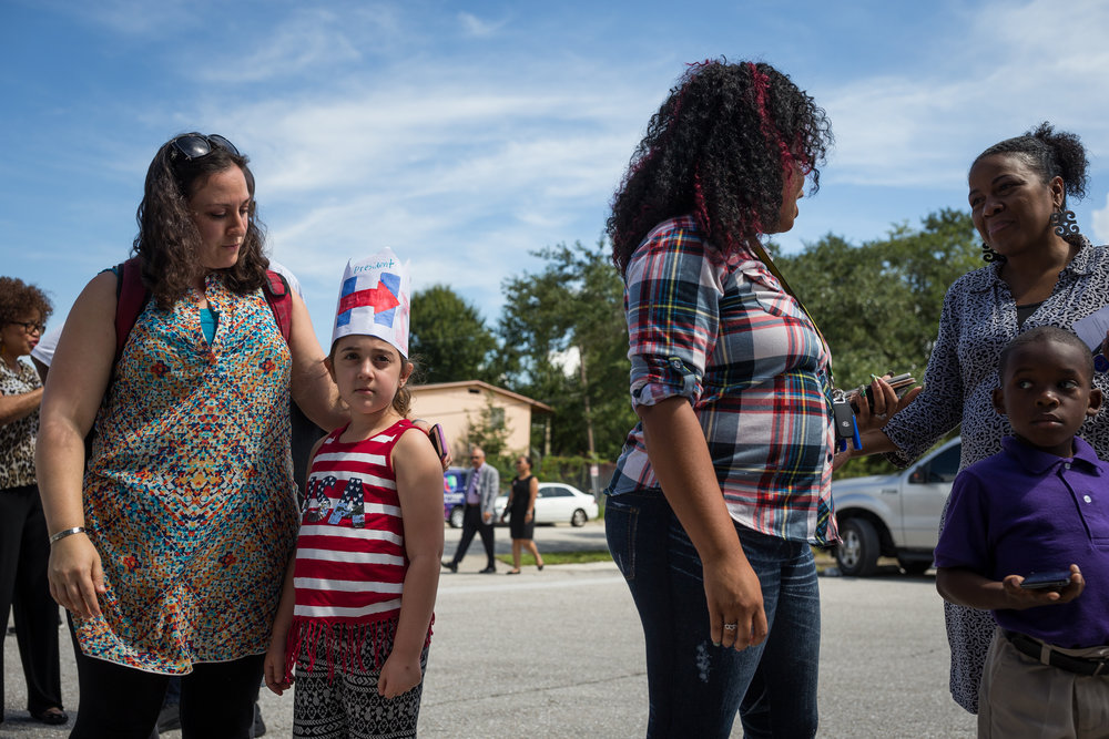 From left, Sharon Skolnik waits in line with daughter Dafna Skolnik, 7, as Jeneka Lloyd does the same with son Jevon Cherry, 6.
