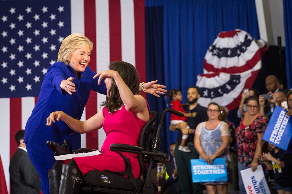 Hillary Clinton hugs Anastasia Somoza, an activist who introduced Clinton before she took the stage.