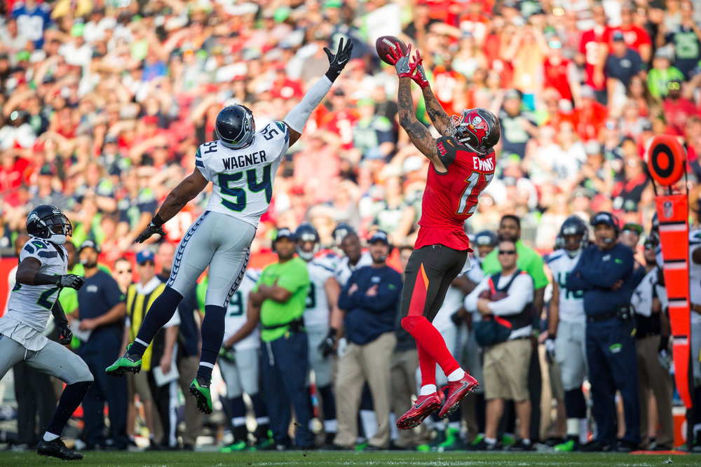 Tampa Bay Buccaneers wide receiver Mike Evans (13) makes a 26-yard reception over Seattle Seahawks middle linebacker Bobby Wagner (54) during the first half of a football game at Raymond James Stadium in Tampa, Fla., on Sunday, Nov. 27, 2016.