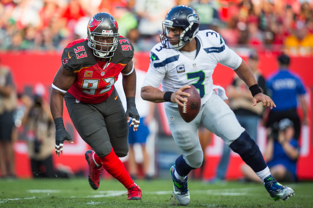 Tampa Bay Buccaneers defensive tackle Gerald McCoy (93) puts pressure on Seattle Seahawks quarterback Russell Wilson (3) and forces him to throw incomplete during the first half of a football game at Raymond James Stadium in Tampa, Fla., on Sunday, Nov. 27, 2016.