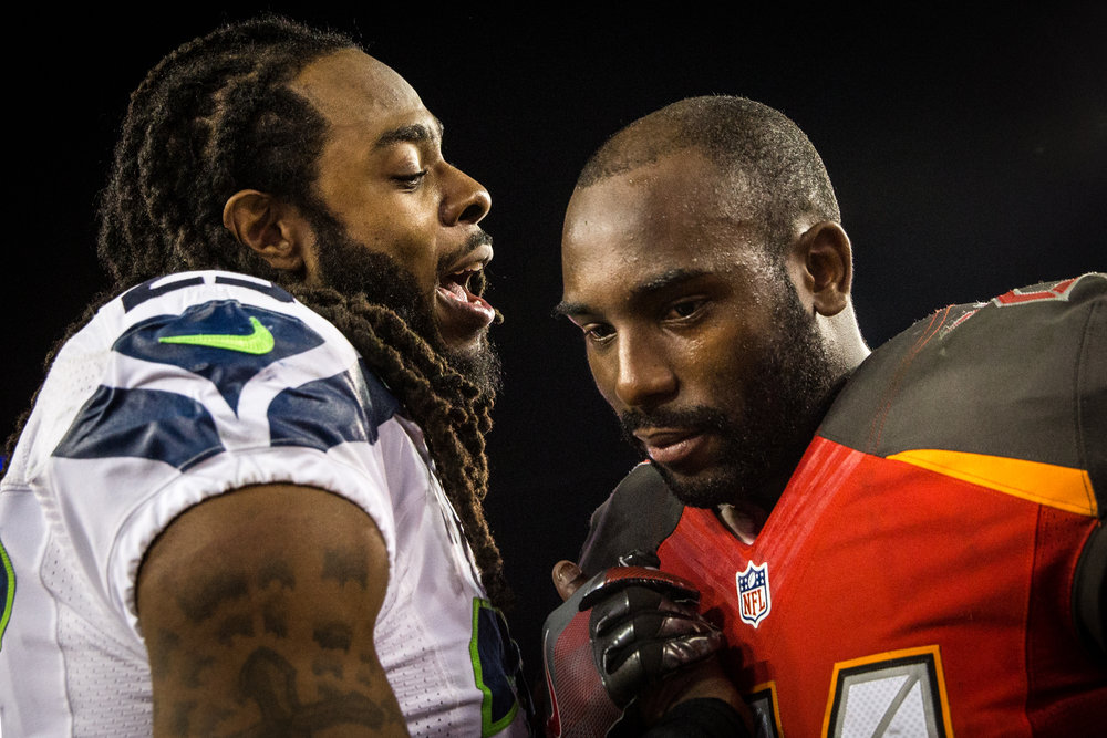 Tampa Bay Buccaneers cornerback Alterraun Verner (21) shakes hands with Seattle Seahawks cornerback Richard Sherman (25) at midfield following a 14-5 Bucs victory at Raymond James Stadium in Tampa, Fla., on Sunday, Nov. 27, 2016. Verner's father passed away Friday morning.