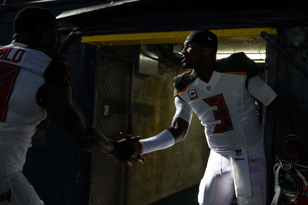 Tampa Bay Buccaneers quarterback Jameis Winston high-fives defensive tackle Clinton McDonald in the tunnel before the start of a football game against the San Diego Chargers at Qualcomm Stadium in San Diego, Calif., on Sunday, Dec. 4, 2016. Winston high-fived each of his teammates before heading for the locker room himself.