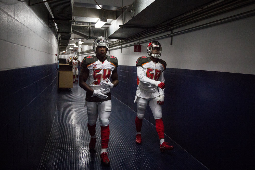 Tampa Bay Buccaneers outside linebacker Lavonte David (54) and middle linebacker Kwon Alexander (58) head to the field before the start of a football game against the San Diego Chargers at Qualcomm Stadium in San Diego, Calif., on Sunday, Dec. 4, 2016.