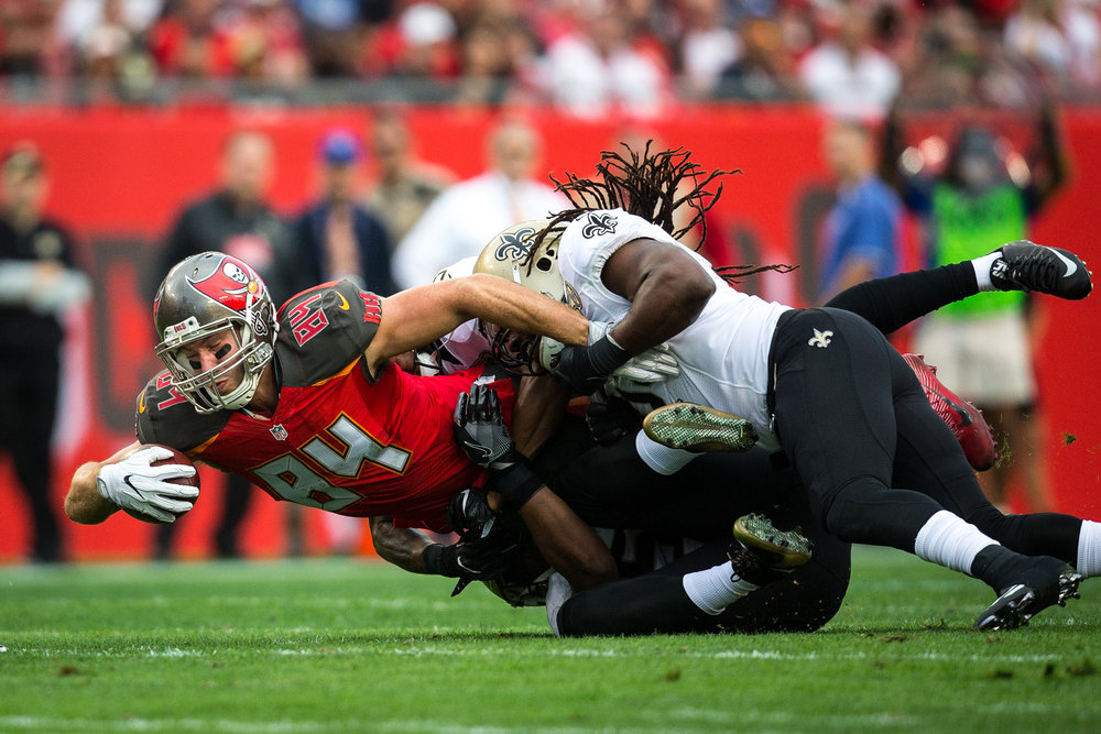 Tampa Bay Buccaneers tight end Cameron Brate is tackled by New Orleans Saints free safety Vonn Bell after making a first down catch during the first half of a football game at Raymond James Stadium in Tampa, Fla., on Sunday, Dec. 11, 2016.