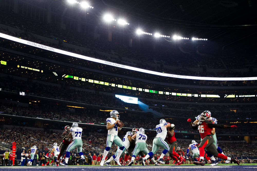 Dallas Cowboys quarterback Dak Prescott (4) looks to pass during the second half of a football game against the Tampa Bay Buccaneers at AT&T Stadium in Arlington, Texas, on Sunday, Dec. 18, 2016.