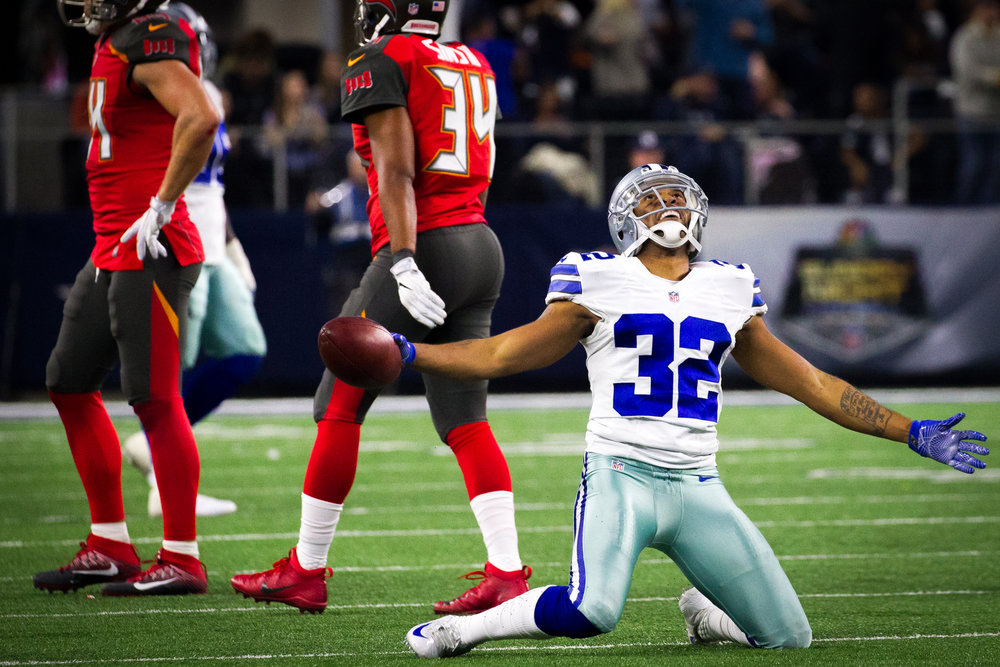 Dallas Cowboys cornerback Orlando Scandrick (32) celebrates after intercepting a pass from Tampa Bay Buccaneers quarterback Jameis Winston (3) to seal a victory late in the fourth quarter at AT&T Stadium in Arlington, Texas, on Sunday, Dec. 18, 2016.