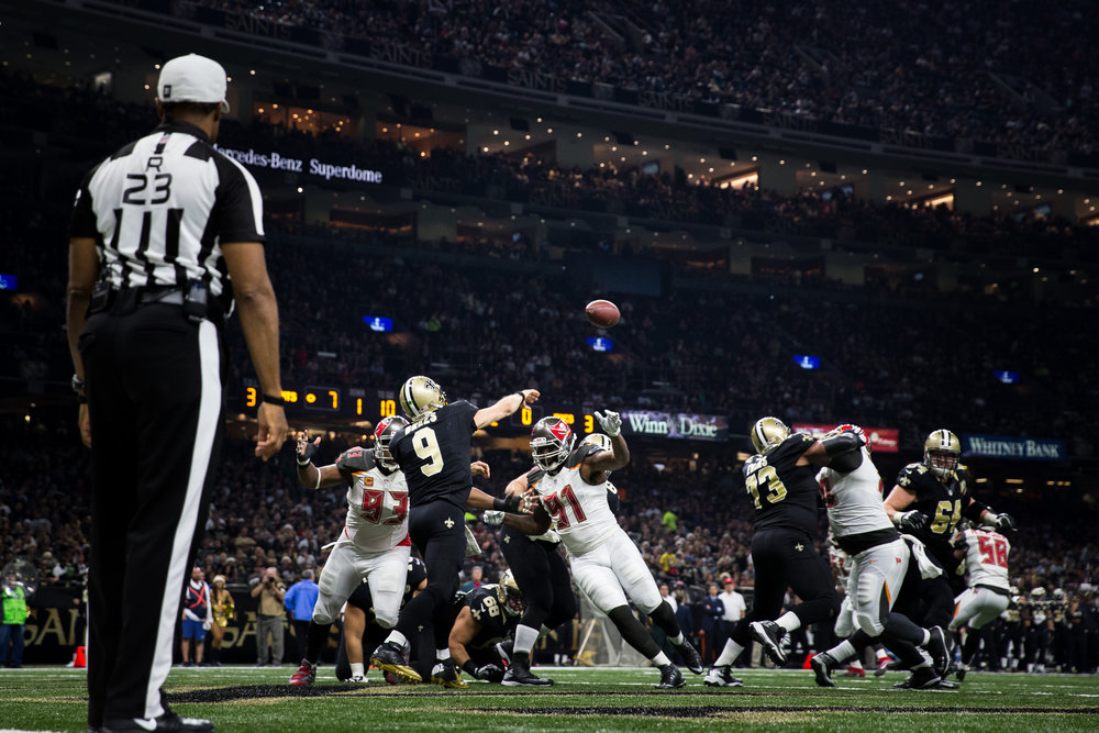 New Orleans Saints quarterback Drew Brees (9) passes under pressure from Tampa Bay Buccaneers defensive tackle Gerald McCoy (93) and defensive end Robert Ayers (91) during the second half of an NFL football game at the Mercedes-Benz Superdome in New Orleans, La.
