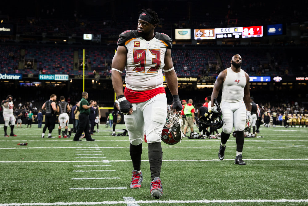 Tampa Bay Buccaneers defensive tackle Gerald McCoy (93) and defensive end Robert Ayers (91) walk off the field after losing 31-24 to the New Orleans Saints at the Mercedes-Benz Superdome in New Orleans, La.