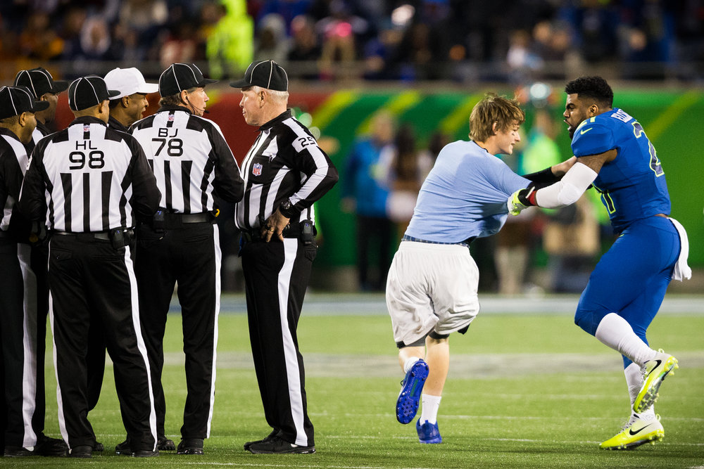 Dallas Cowboys running back Ezekiel Elliott tackles a fan who ran onto the field during the second half of the AFC–NFC Pro Bowl at Camping World Stadium in Orlando, Fla., on Sunday, Jan. 29, 2017.