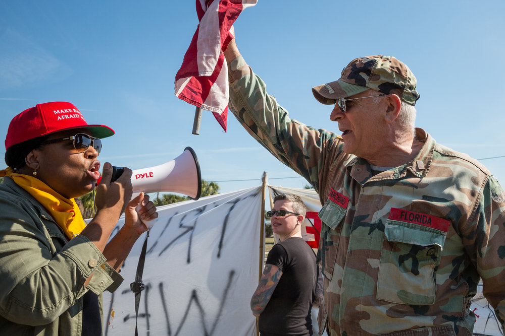 "Trump supporter Peter Chianchiano (right) clashes with Donna Davis, co-founder of the Tampa chapter of Black Lives Matter, at a ""Trump Not Welcome"" protest near the corner of Interbay Boulevard and South Dale Mabry Highway in Tampa, Fla., on Monday, Feb. 6, 2017. A Trump visit to MacDill Air Force Base prompted the protest."
