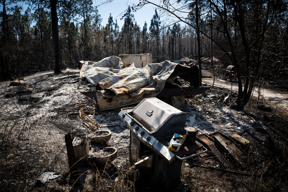 A home destroyed by fire is seen in a burnt area next to Highway 630 East near Indian Lake Estates on Friday, Feb. 17, 2017.