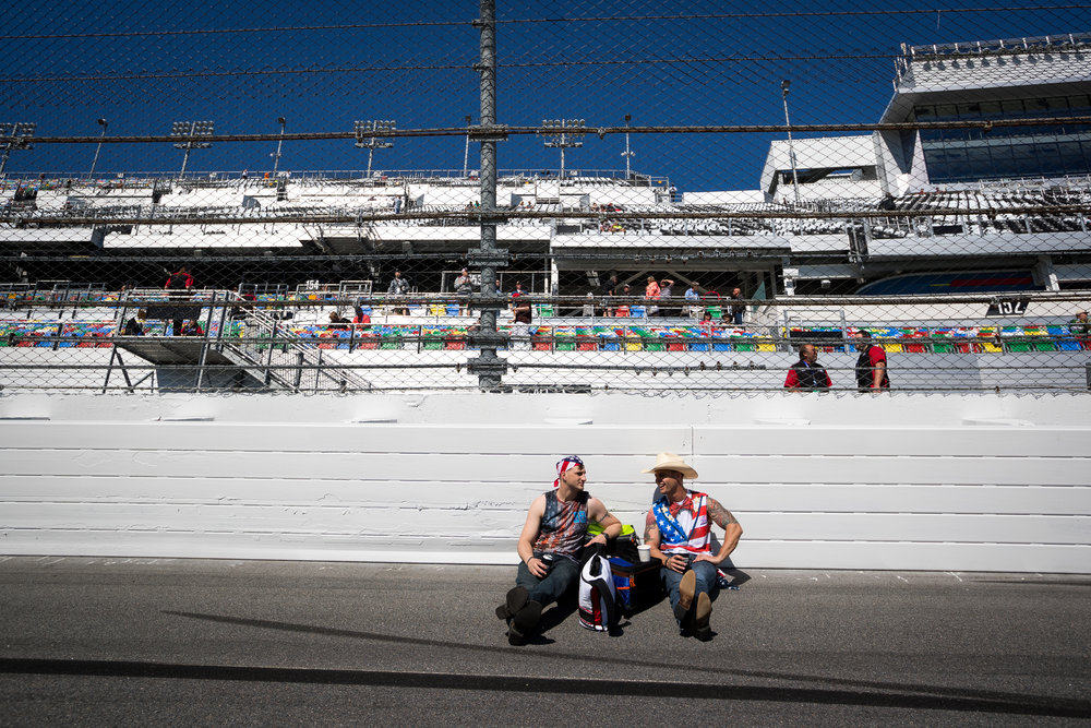Fans TJ Unger (left) and Don Hill hangout on the track before the Daytona 500 NASCAR race at Daytona International Speedway in Daytona Beach, Fla., on Sunday, Feb. 26, 2017. They made the trip down from North Carolina to see the race.